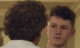 two men look at each other
