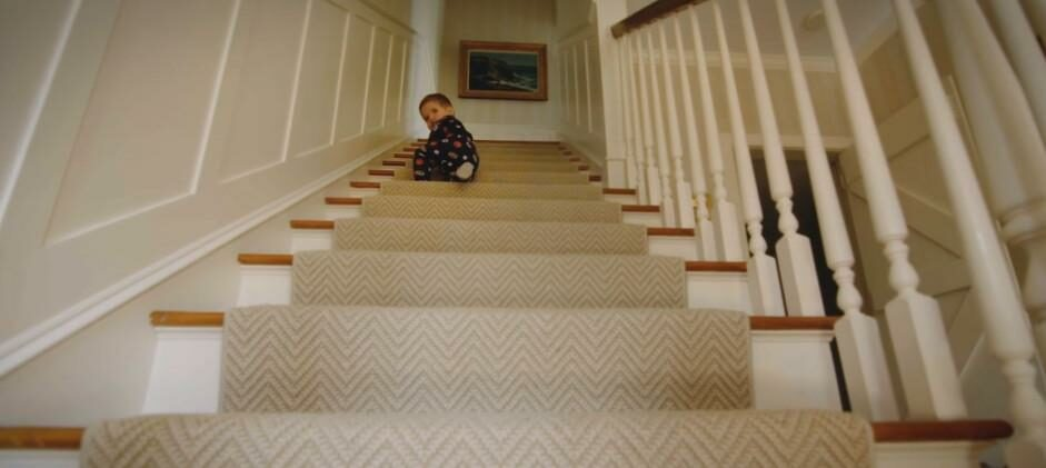A baby on the stairs.