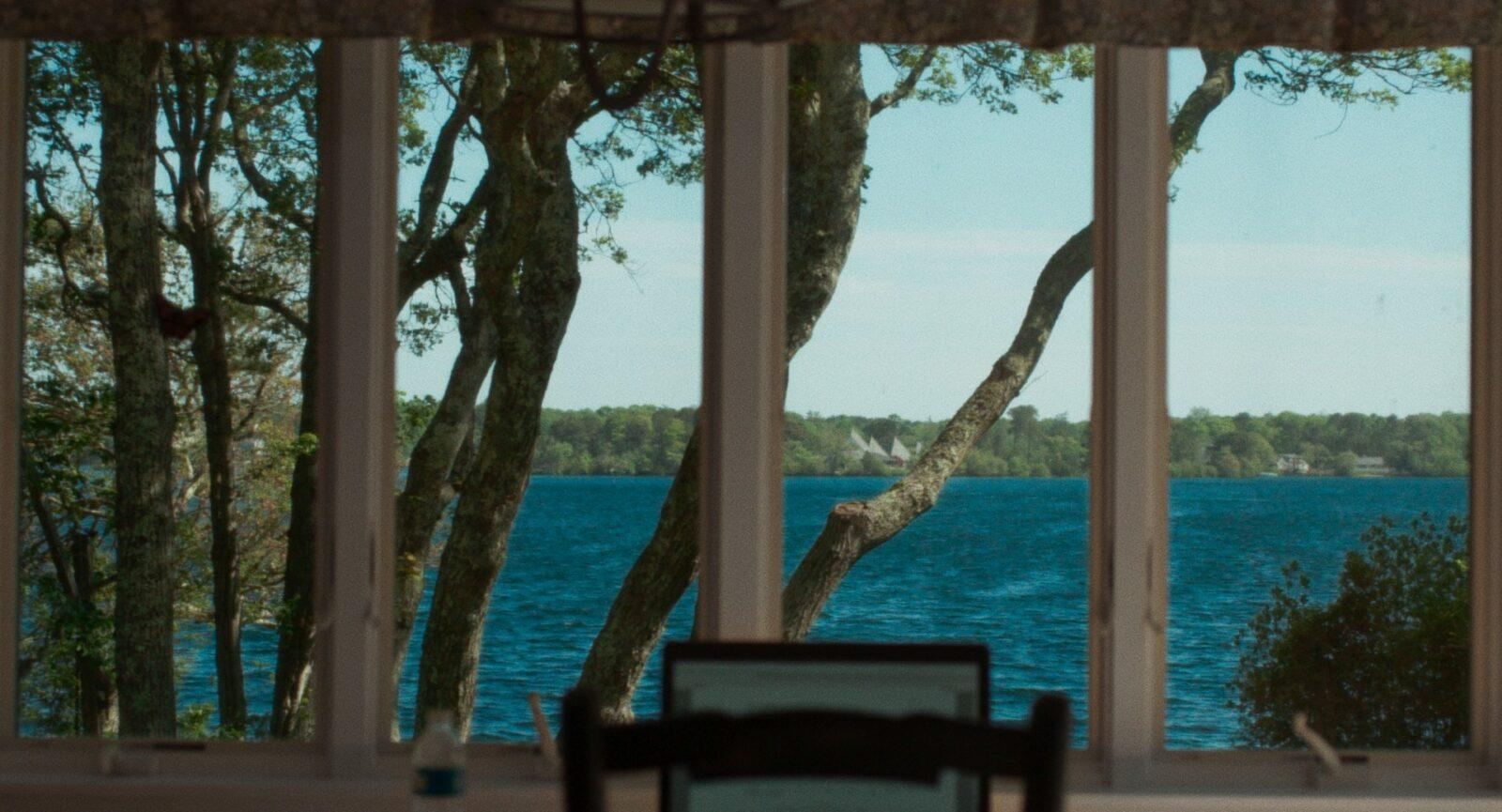 A window with a view of the water.