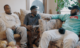 three men on a sofa